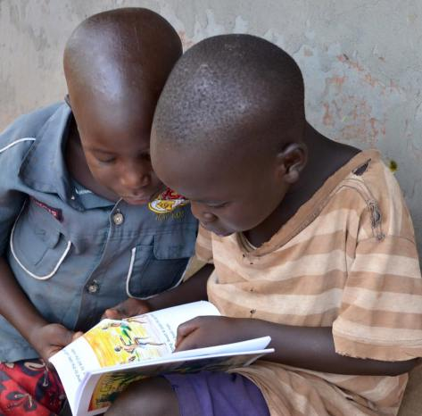 Ugandan kids with the fable books